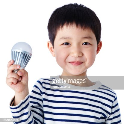 Little boy with LED light bulb