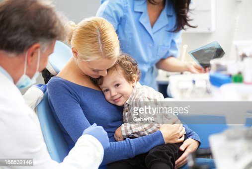 Little boy with mother at dentist office : Stock Photo