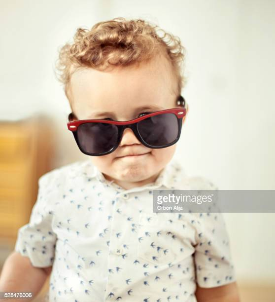 Little boy with oversized sunglasses