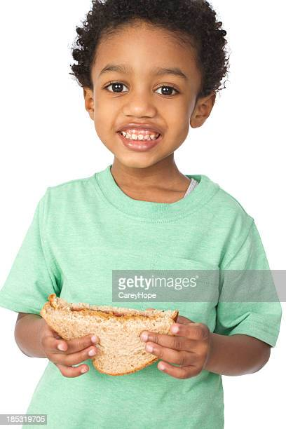 little boy with peanut butter and jelly sandwich