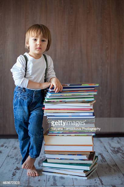 Little boy with pile of books