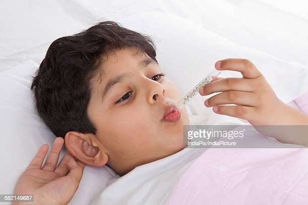 Little boy with thermometer in his mouth