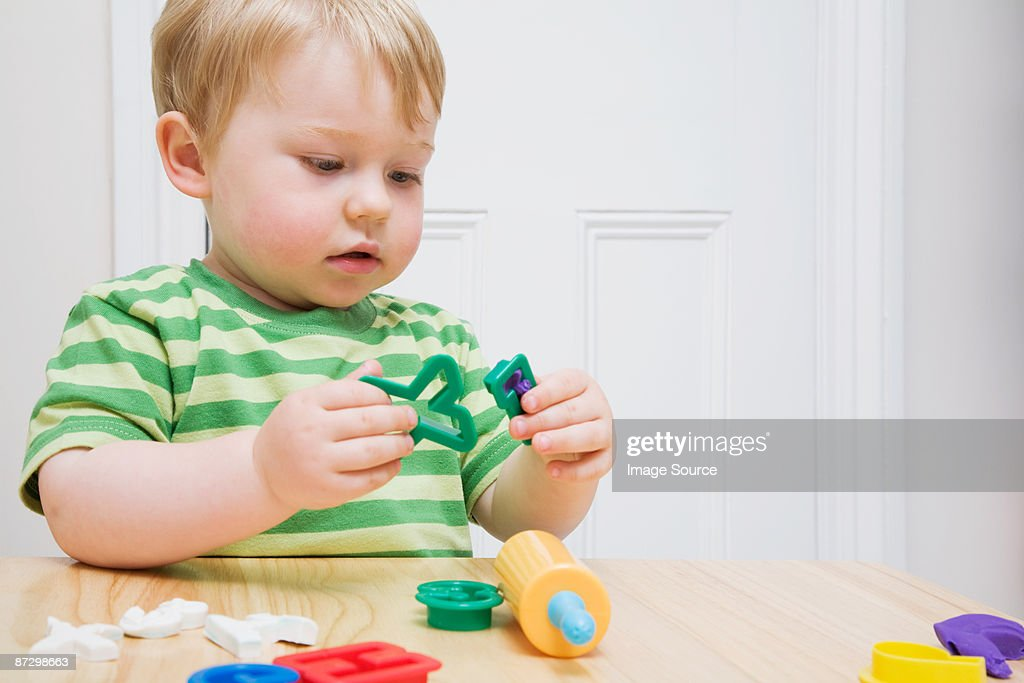 Little boy with toys : Stock Photo