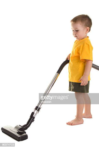 Little boy with vacuum-cleaner