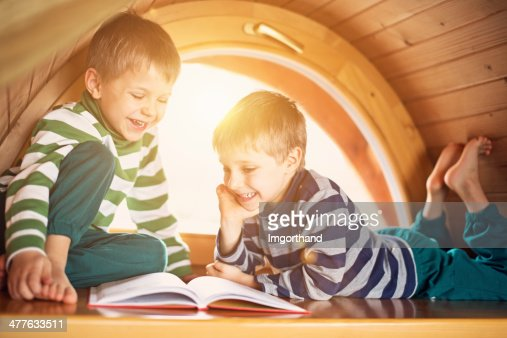 Little boys having fun reading. : Stock Photo