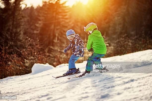 Little boys having fun skiing