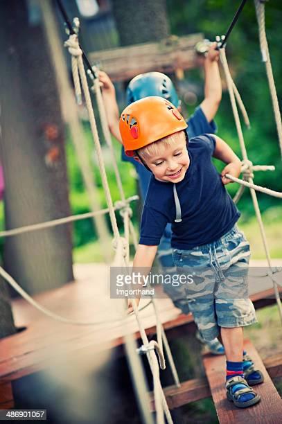 Little boys in adventure park.