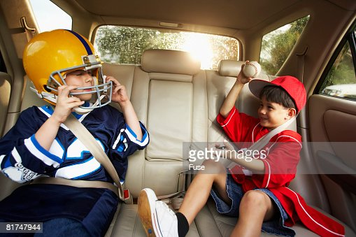 Little Boys Playing in Back Seat