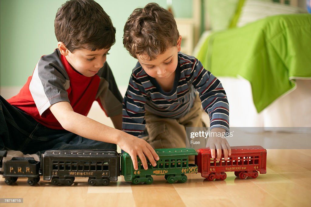 Little Boys Playing with Toy Train