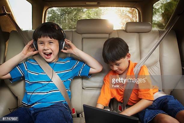 Little Boys Riding in Back Seat