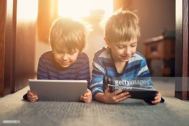 Little boys using digital tablets