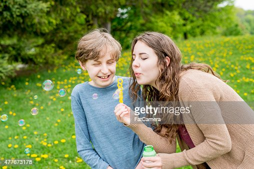 little brother blowing brothers with older sister stock photo getty images. Black Bedroom Furniture Sets. Home Design Ideas
