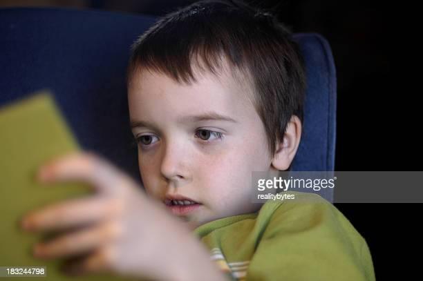 Little Caucasian Boy Learning to Read