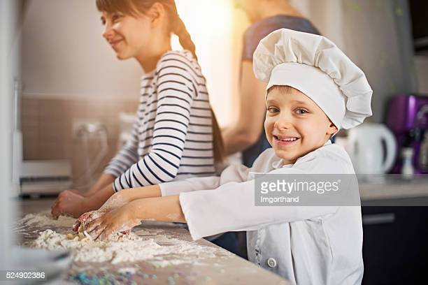 Little chef with family having fun with baking