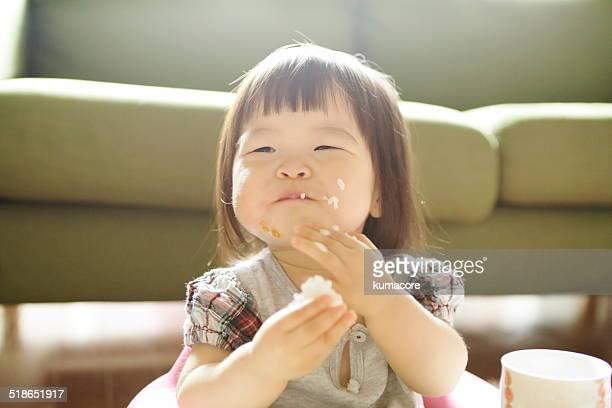 Little child eating.