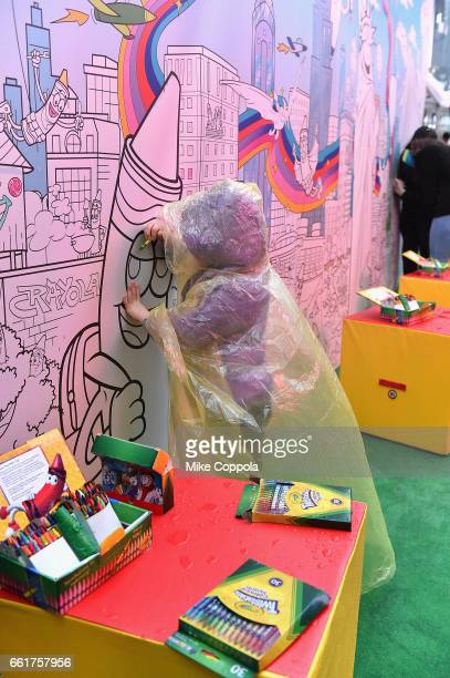 A little child makes their mark on a coloring wall at Crayolas National Crayon Day celebration at an event in Times Square on March 31 2017 in New...