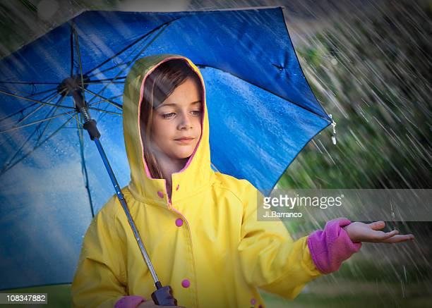 Little Child with Umbrella in the Rain