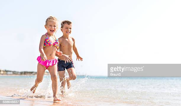 Little children having fun on the beach.