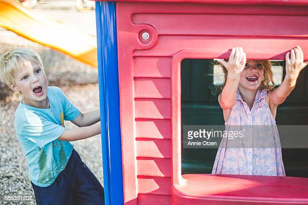 Little Children Playing in Play House