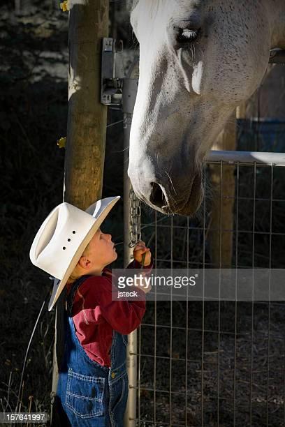 Little Cowboy-Feeds Big Horse