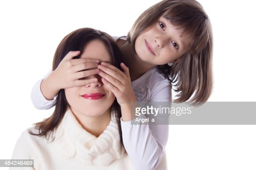 Little daughter hiding mothers eyes : Stock Photo