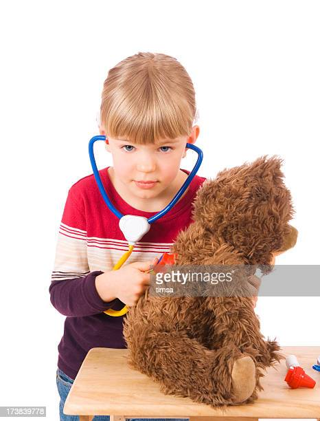 Little doctor with a teddy bear