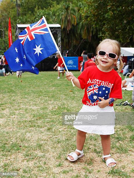 Little Ella Stratton poses in Hyde Park with her Aussie Flag as part of Sydney's Australia day celebrations on January 26 2009 in Sydney Australia...