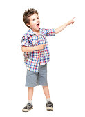 A little excited boy pointing at something isolated on white