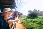 Little expiorer boy with his father on safari