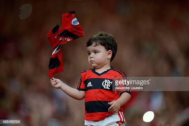 Little fan of Flamengo during the match between Flamengo and Corinthians as part of Brasileirao Series A 2014 at Maracana stadium on September 14...