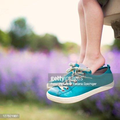 Little feet, big shoes : Stock Photo