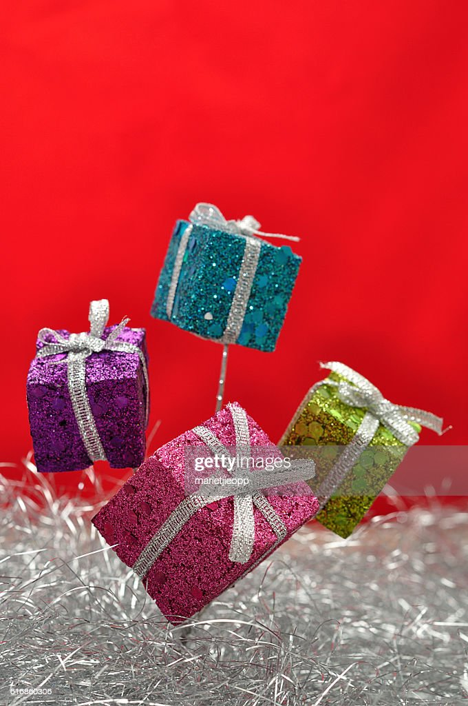 Little gifts in shinny wrapping for decorating a Christmas tree : Stock Photo