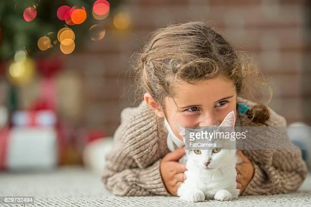Little Girl Adopting a Kitten