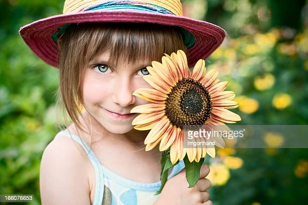 Little girl and a sunflower
