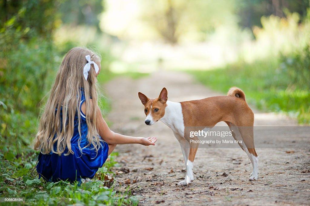 Little girl and basenji