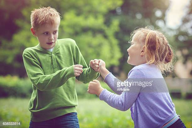 Little girl and boy in conflict