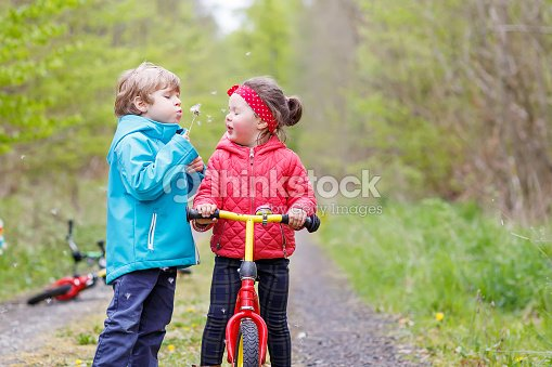 fef26ce4c Little Girl And Boy Playing Together In Forest Stock Photo
