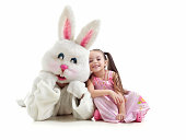 Little girl and bunny fighting
