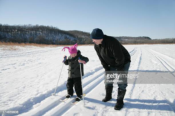 Little Girl and Her Father Cross Country Skiing