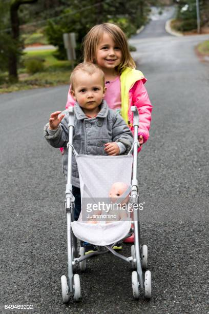 Little girl and her little brother looking at the camera