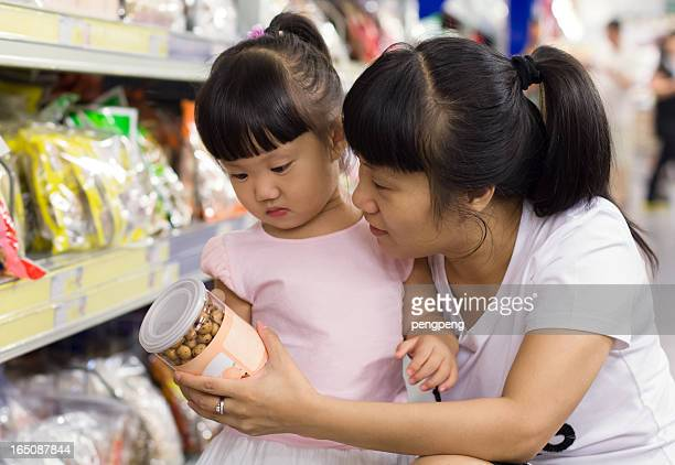 Little girl and her mother shopping