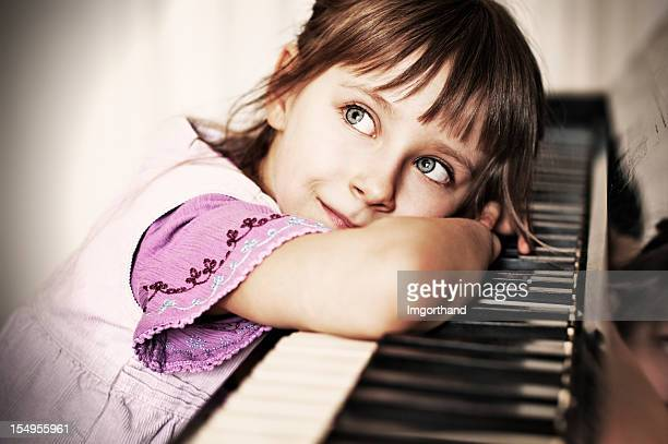 Little girl and her piano