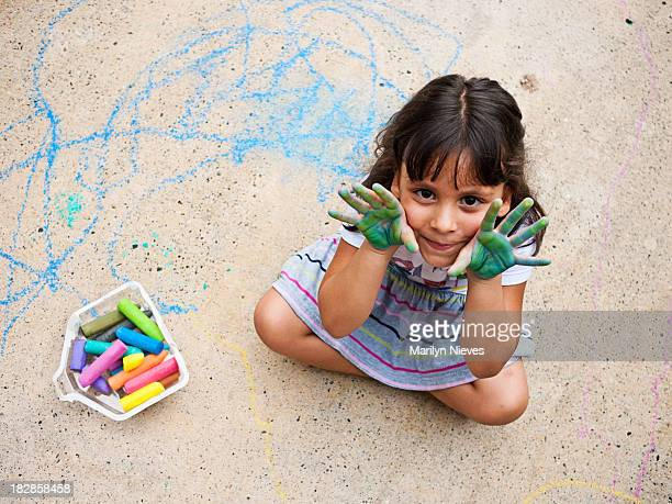little girl and her sidewalk art