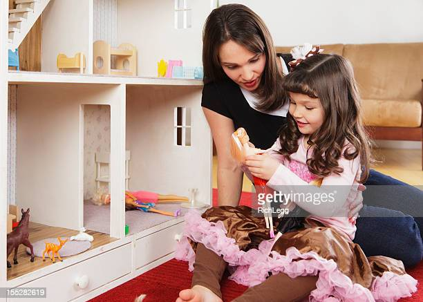 Little Girl and Mom with Dollhouse