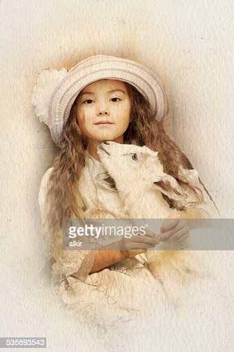 Little girl and pet goat : Stock Photo