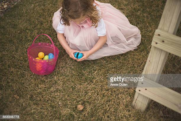 Little girl and plastic eggs