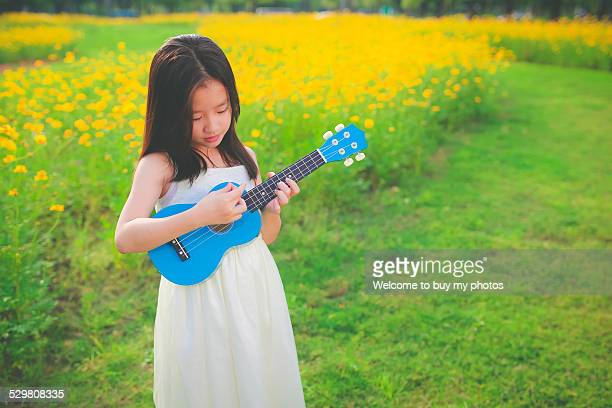Little girl and ukulele