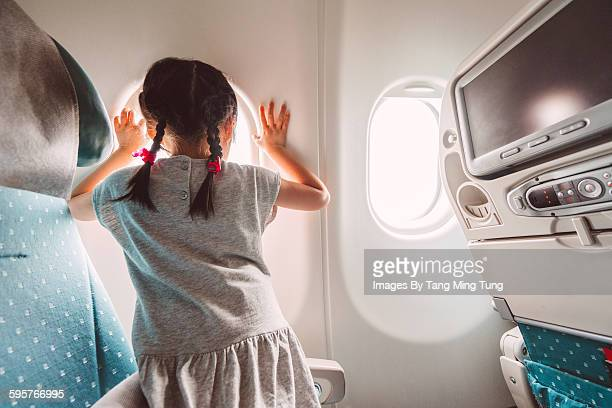 Little girl anticipating aeroplane to take off