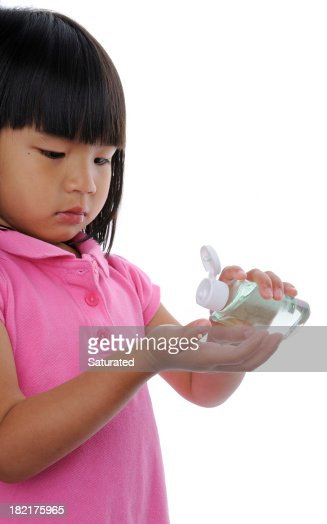 Little Girl Applying Hand Sanitizer