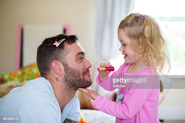 Little Girl Applying Make-up to her Daddy.